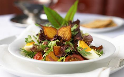 Salad served at the fine dining steakhouse, Chops Grille. Best cruise vacation restaurant dining served table side.