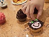 Woman Decorating her Cupcake as a Bear