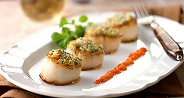 Oven baked almond crusted scallops w/red bell pepper pesto served at Giovanni's Table. Cruise fine dining Italian Restaurant