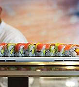 Sushi Chef Serving a Salmon Roll