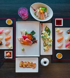 A top-down view of assorted dishes on a table at Izumi on a Royal Caribbean ship