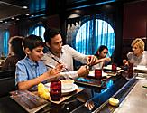 Izumi Hibachi Family Enjoying Meal