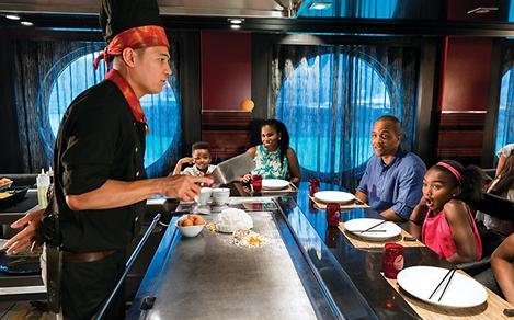 Family Enjoying a Hibachi Chef Cooking