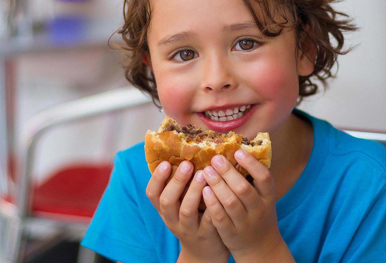 Kid eating a burger, Johnny Rockets