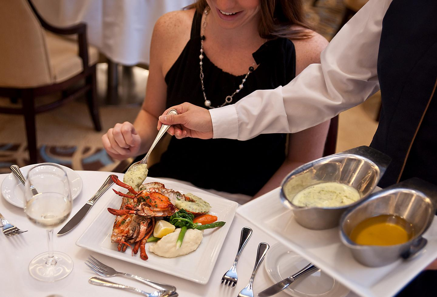 Woman Enjoying Lobster at the Main Dining Room