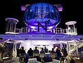 QN, North Star, NorthStar, onboard activities, front view on deck, North Star Bar underneath at night, evening, people at bar
