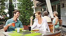 Couple Having Breakfast at Park Cafe
