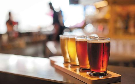 Draft beer flight served at Playmakers Sports Bar & Arcade