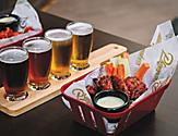 Chicken wings and beer served at Playmakers Sports Bar & Arcade