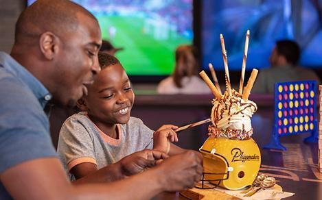Dad and Son Enjoying Ice Cream Sundae