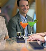 LB, Liberty of the Seas, young couple, man, woman, smiling, laughing, at R-Bar, R Bar, bartender serving mixed drinks, enjoy, enjoyment, fun,
