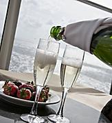 Room Service Bottle Glass Champagne and Strawberries