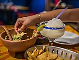 Woman Enjoying Guacamole and Margaritas
