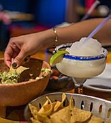 Woman Enjoying Guacamole and Margaritas