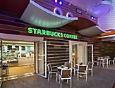 HM, Harmony of the Seas, Starbucks - Deck 6 Portside Aft,  Boardwalk, no people, exterior, entrance to cafe, coffee shop, signage, tables, chairs,