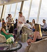 Oasis Suite Lounge Guests Enjoying Drinks