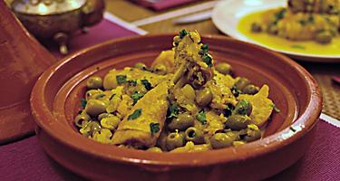 Local cuisine in Abu Dhabi is chicken tagine with preserved lemon and green olives