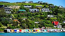Colorful houses along the mountains in Akaroa, New Zealand