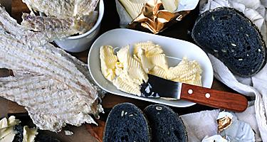 Hardfiskur dried fish with a side of charcoal bread and butter