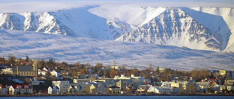 View of Akureyri, Iceland with ice covered mountains in the background
