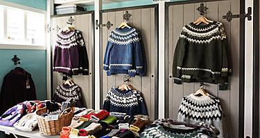 An assortment of wool sweaters at a store