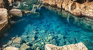 Clear blue water within a cave in Iceland