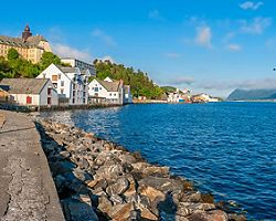 Rocks lining the sea wall in Alesund, Norway