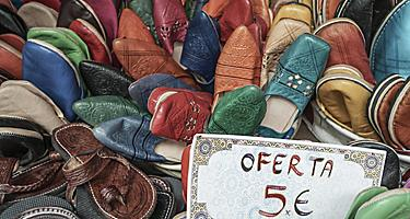 Leather shoes for sale at a market in Spain