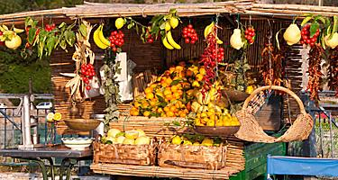 An assortment of fresh fruit at a stand in the Amalfi Coast