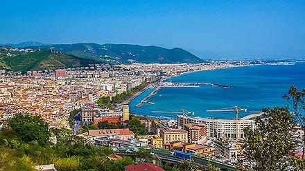an aerial view of the coastal city of Salerno, Italy