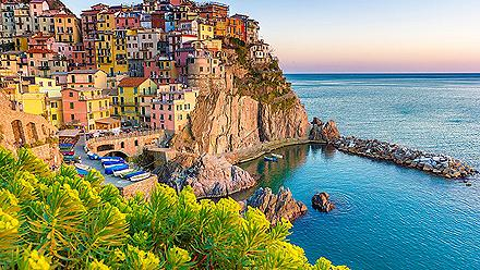 Multicolored homes lining a cliff at an Amalfi Coast city