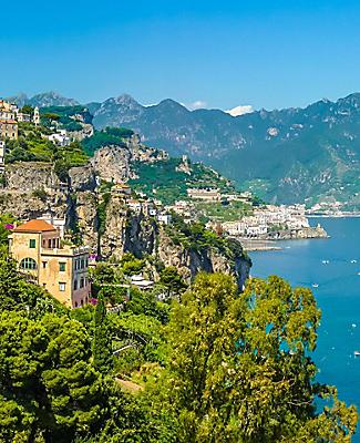 Homes lining a lush green mountain in the Amalfi Coast