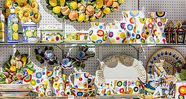Assorted ceramic goods for sale at a shop in the Amalfi Coast