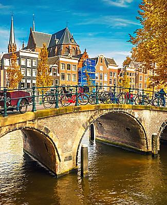 Sunset shot of bridges over canals during Autumn in Amsterdam, Netherlands