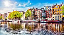 The Amsterdam dancing houses over Amstel river in Amsterdam, Netherlands