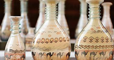 Bottles made of shape with shapes of deserts and camels while shopping in Aqaba, Jordan
