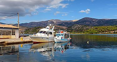 Fishing boats anchoring by Koutavos Lagoon in Argostoli, Greece