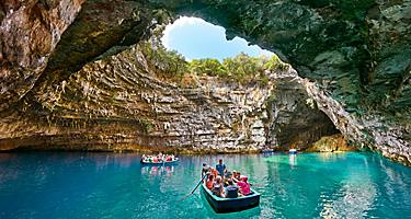 Tourist boat on the lake in Melissani Cave in Argostoli, Greece