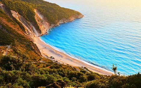 Sunset at famous Myrtos beach in Argostoli, Greece