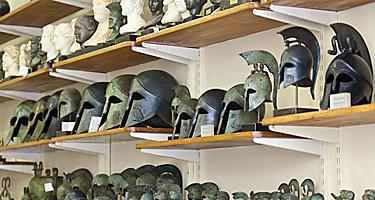 An assortment of Greek souvenirs such as helmets and sculptures