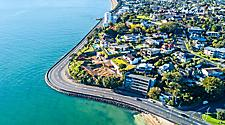 Aerial view of a coastal road in Auckland, New Zealand