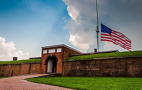Fort McHenry raising the American flag, Baltimore, Maryland