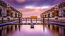 Purple sunset at waterfront in Inner Harbor in Baltimore, Maryland