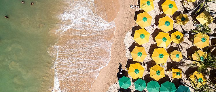 banana coast honduras tropical beach top view umbrellas