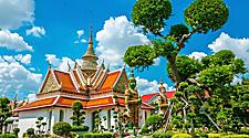 Great palace Buddhist temple with famous green tree gardens in center of Bangkok, Thailand