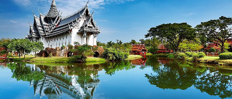 The Sanphet Prasat Palace with reflections along the water in the Ancient City of Bangkok, Thailand