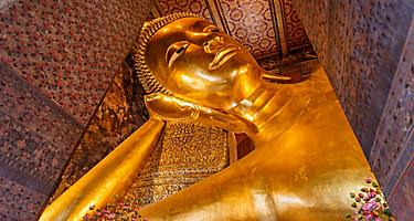 The reclining buddha gold statue face in Wat Pho Bangkok, Thailand