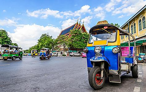 The blue tuk tuk is the traditional taxi car in Bangkok