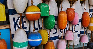An assortment of colorful wooden float souvenirs in Bar Harbor, Maine