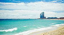 Barceloneta Beach at sunset, with a view of the W Hotel in Barcelona, Spain